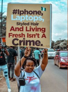 A lady pictured protesting against police brutality in Nigeria