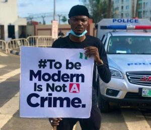 EndSARS protester pictured with placard